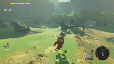 link riding epona towards an ancient wall legend of zelda breath of the wild screenshot