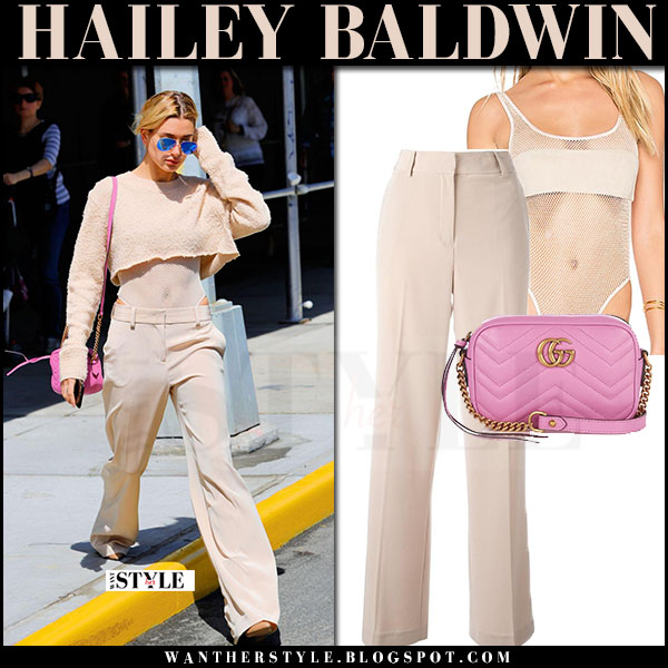 Hailey Baldwin in nude trousers, sheer bodysuit, knit crop top with pink bag gucci gg marmont what she wore april 2017
