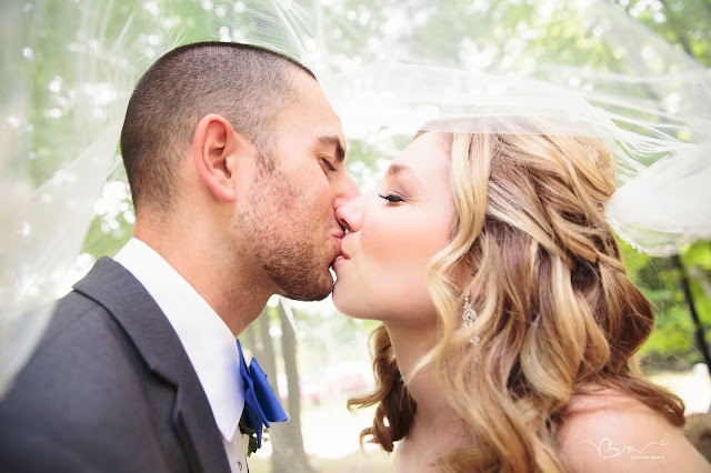kissing photo at Noah's Event Venue in Auburn Hills Michigan