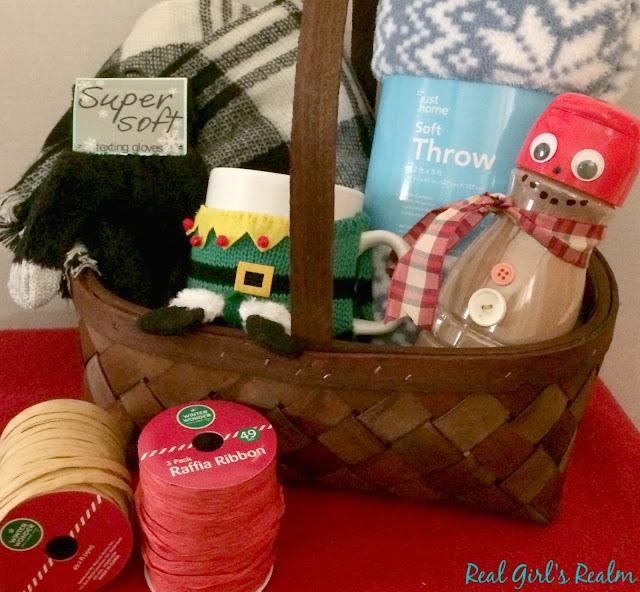 Make a Cozy Themed basket that has everything you need for a snowy day, curled up on the couch, including a cocoa-filled snowman!