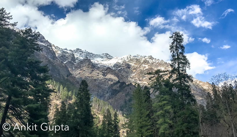 Well this write-up gives you some insight of my experiencewith KheerGanga. I am not a avid trekker but I love to travel. So while lookingfor an outstation trip I was searching some place in Himachal. This time mysearch gave me KheerGanga as an option. I had done Triund trek (Mcleodganj)twice before this.So before finalizing  KheerGanga, I have read lot about it. And fromall my reading I concluded that it is more challenging than Triund. Lots ofpeople had mentioned the beauty of this trek. So I decided to do it.We were total three college friends. Its been 7 years sincewe are out of college and since then we were trying to find time to go on atrip together.We started on Friday evening from Delhi at around 8 PM. Wereached Murthal at around 10 PM where westopped for Dinner. After having aquick break we started around 10.45PM and then we drove for next 5 hours. Wethen stopped for a Tea Break. So after crossing Mandi, Sunder Nagar, Kasol wereached Barshaini. Barshini is the point till where you can go by Car/Taxi.Himachal State Transport also ply buses from Mandi to Barshaini.Barshaini gives you option to stay but they give you verybasic facilities. Although we didn't halt at Barshaini. The point from wherethe Trek starts is basically a Dam construction site. They are constructing ahug dam on Parvati river. We parkedthe car. We then took our trekking bagswith necessary stuff like jackets, extra socks, towels, gloves, cap, torch andthen we headed towards our target. Its been said that the trek is 12 Kms long.The view of the Parvati valley from the point where trek starts wasspectacular. It gives you energy to start the trek. It attracts you and thenyou without wasting any time starts heading towards it.Along the trek you will find good number of shops which are managedby local villagers. They serve you Maggi, omlette chai etc along with dry snacksand fruits as well. You dont really need tocarry any food item for this trek.We started our trek at around 12 noon. After 2 kms we foundone café/shop and we stopped there for a quick break. After having maggi wethen started our trek and reached Rudranag. It is almost at the middle of trek.There is a waterfall at this point which looks like snake and thus this pointis named after it. To reach Rudranag it took almost 90 mins from the last stop.We had fruits/tea at a shop here and then we started again.So, after having a good break of about 20 mins we startedour journey again. And immediately  therecomes an interesting wooden bridge over river Parvati. This pics says all. Iwas quite scared crossing this bridge. JAfter this point the terrain becomes more difficult, and it isalmost 2 hours from this point to reach our destination. In this part there arewater streams, steep paths and beautiful views.We reached at around 4 PM to the top.  And the view from here are spectacular. Heris a glimpse of that.To my surprise, there were so many eating outlets along withplaces to stay. I must stay rooms and halls for stay were way beyond myexpectations. Here you will even find currency exchange counter as lot offoreigners come to this place.Atthe top there is a temple and close to it there is a Hotwater spring. It has proper arrangements for women. Water is quite hot but itis very very relaxing. We booked one room with three beds. The rent was veryvery nominal. He charged us 200/- per bed. The sky view at night was awesome.It was clear and mind blowing. We slept early as we were really tired. We wokeup at around 4 AM next morning. After roaming here & there for some time,we started our back journey at around 5 AM. Slowly slowly we have reached fromwhere we started. Surprisingly it took us almost 4 hours to descendwhichincludes 40 Mins break for breakfast. On this way we found apple and peachtrees.  Kheerganga was a beautiful experience but I was greatlydisappointed after realizing that it is becoming more & morecommercialized. We should respect the nature JI found this written over a rock on the trek.