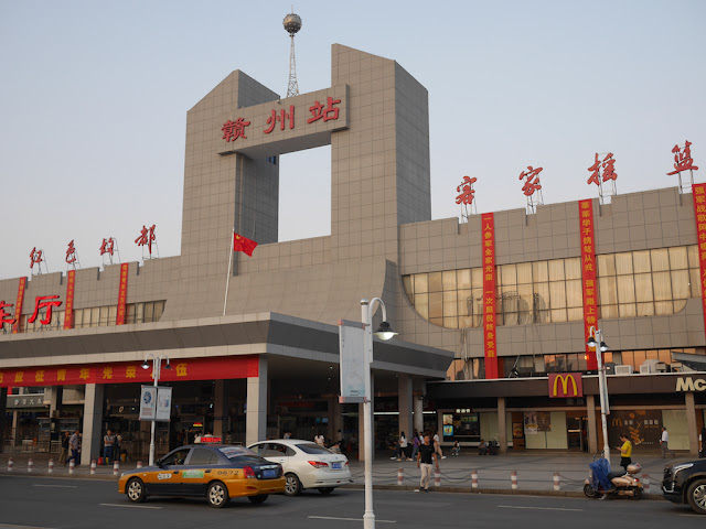 front of Ganzhou Railway Station and a McDonald's