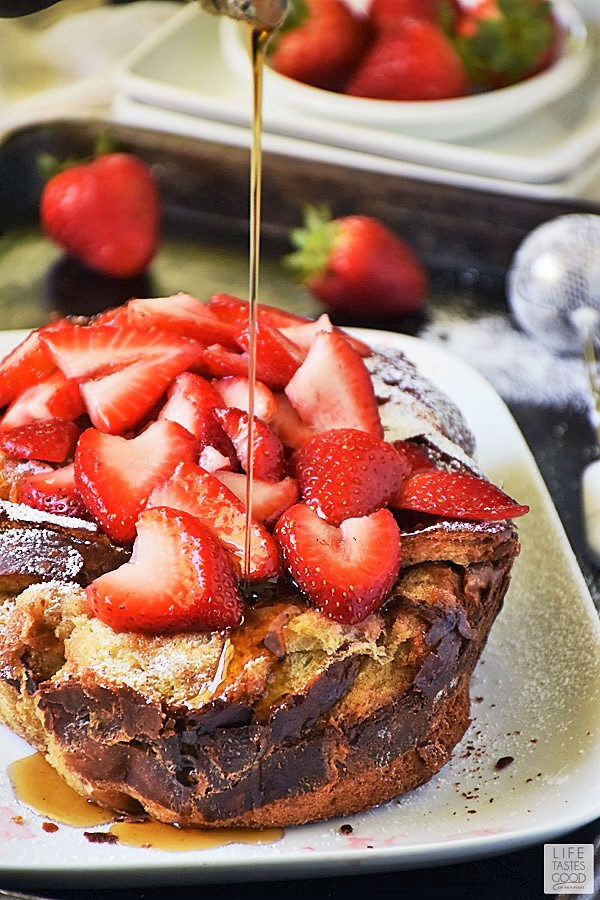 Slow Cooker French Toast with strawberries and maple syrup drizzle