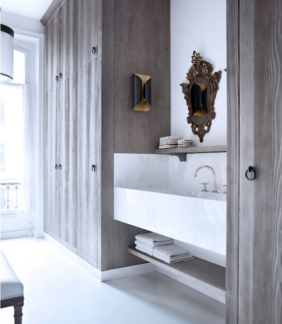 Gilles & Boissier design with timber closets, ornate mirror above the marble sink via belle vivir blog