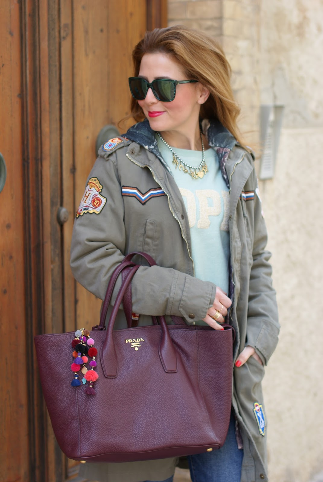 Simple casual outfit with Parka jacket and Prada bag on Fashion and Cookies fashion blog, fashion blogger style