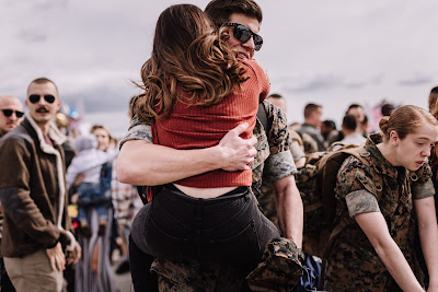 Marine and Wife reuniting at their homecoming after a long deployment at Marine Core Air Station Miramar with VMFA 225 by Morning Owl Fine Art photography San Diego.