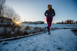 Woman running on snowy path