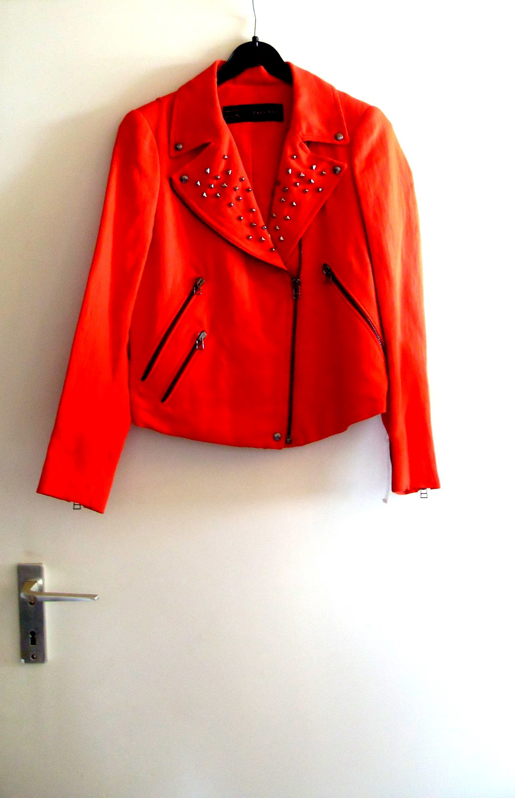 0e4672bb982 Strangeness and Charms  zara red studded biker jacket.
