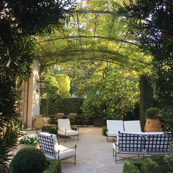 Magnificent French country courtyard with antique urns and pea gravel - Pamela Pierce.