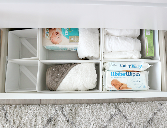 drawers organised with ikea separators for baby products in nursery
