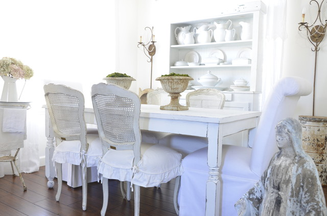 Eclectic Dining Room with White Dining Room Tables And Chairs on the Wooden Floor near White Shelves