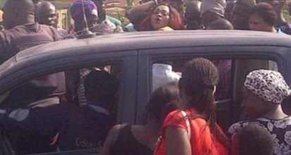 actress Mercy Aigbe being forced into the car after her arrest by police in Osogbo on wednesday