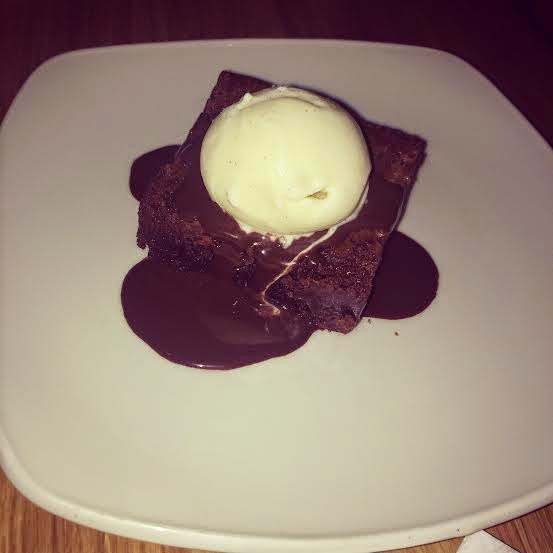 brownie and ice cream with chocolate sauce