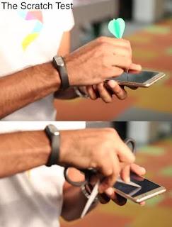 mengetes layar anti gores ponsel redmi note