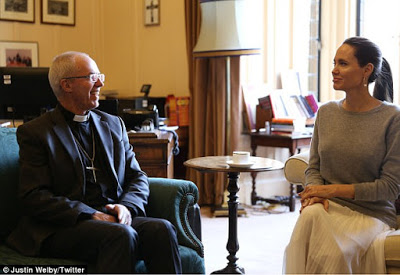 Social media erupts as Angelina Jolie shows up braless for a meeting with the Archbishop of Canterbury
