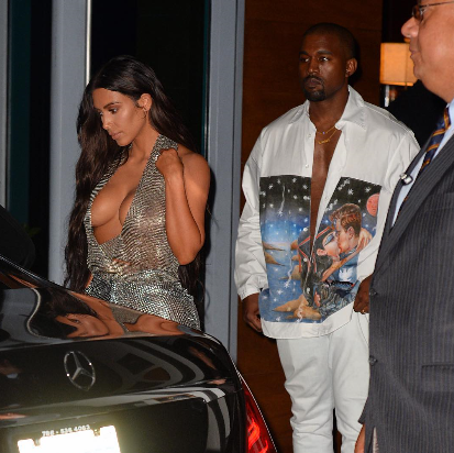 Kim K goes braless again as she attends Kanye West concert in Miami
