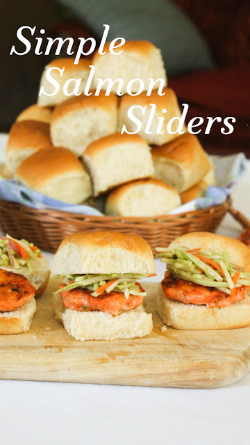 Food Lust People Love: These simple salmon sliders are easy to make and take mere minutes to cook. Topped with sesame ginger slaw, they are fresh and flavorful, a fun appetizer or main course your friends and family will love.