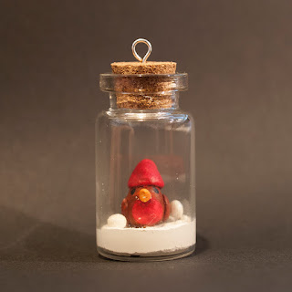 Robin in a jar by welaughindoors