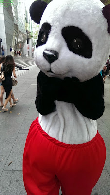 Person in panda costume