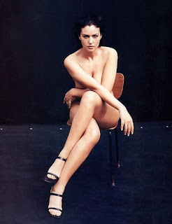 Monica Bellucci Legs Expose While Sitting On Chair