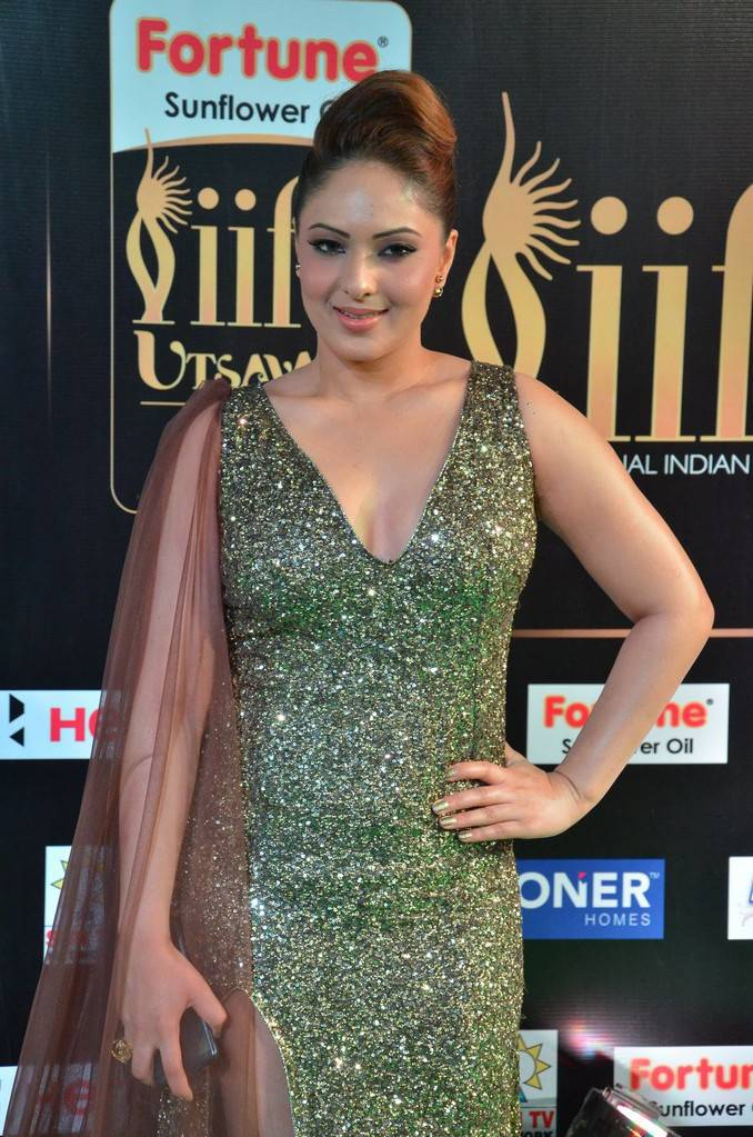 Nikesha Patel Stills At IIFA Utsavam Awards 2017 In Green Dress