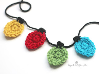 http://www.repeatcrafterme.com/2015/11/crochet-christmas-light-appliques.html