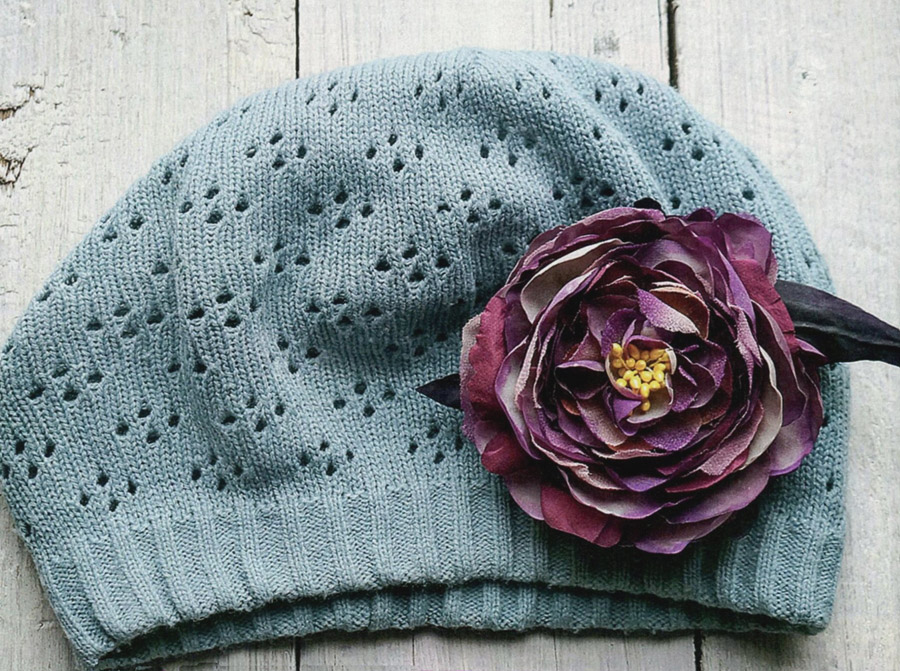 The flower on the hat