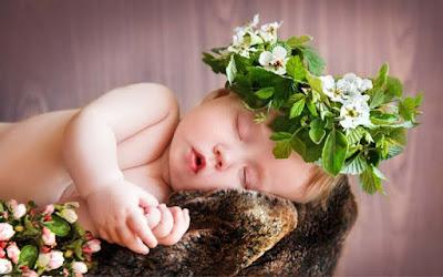 sleeping-soft-silkybaby-wearing-flower-croftan-on-head