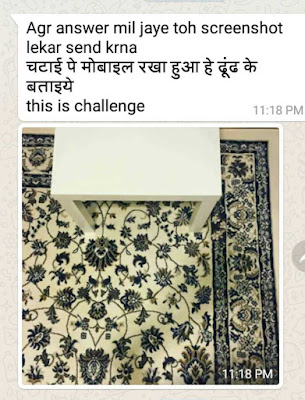 find the mobile phone in this picture answer