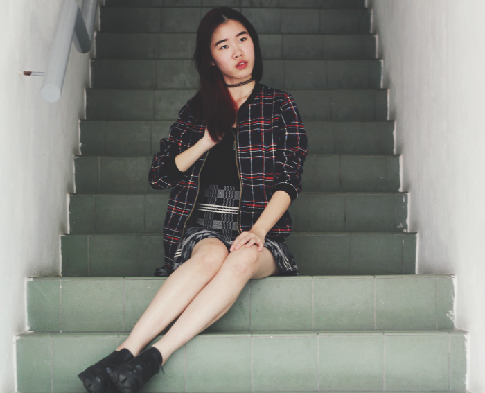 Brunei Blogger May Cho mixes tartan and plaid for a grunge chic look