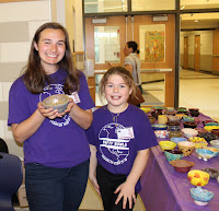 Empty Bowls Club Member Megan Torey (left) and event attendee Kate Cataldo