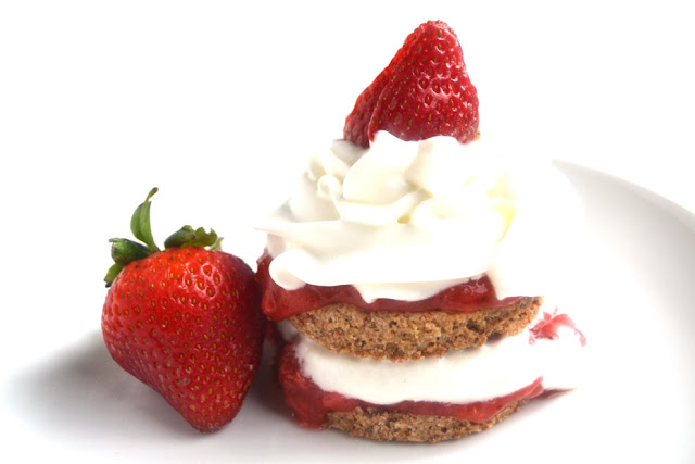 These Strawberry Rhubarb Shortcakes are the perfect summer dessert. The shortcakes are made with only 5 ingredients and the sauce is the perfect mix of sweet and tart! www.nutritionistreviews.com