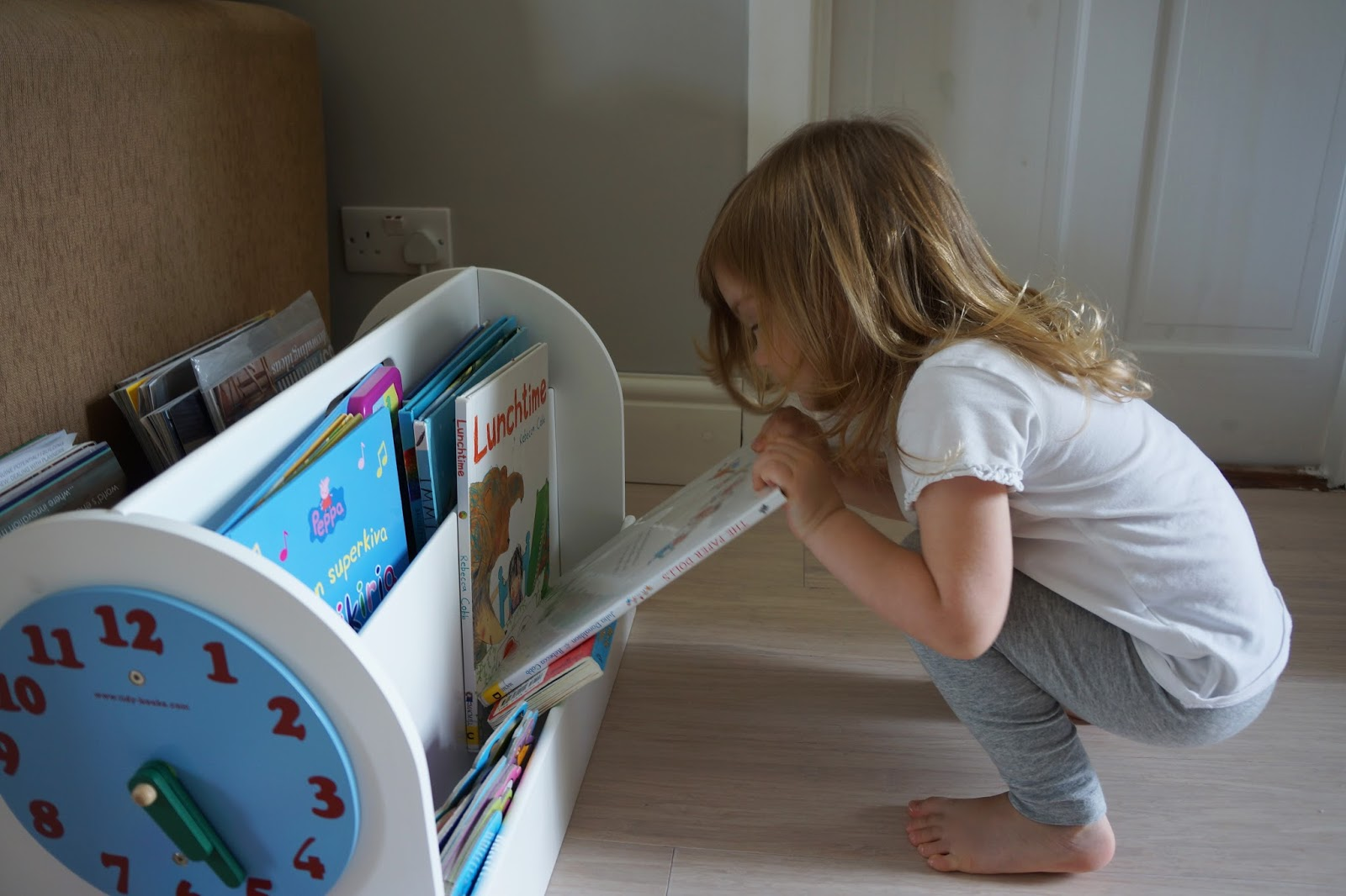 toddler using a tidy books box