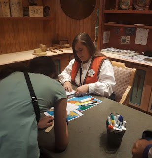 EPCOT Kidscot Passport getting it stamped at Norwar Pavilion