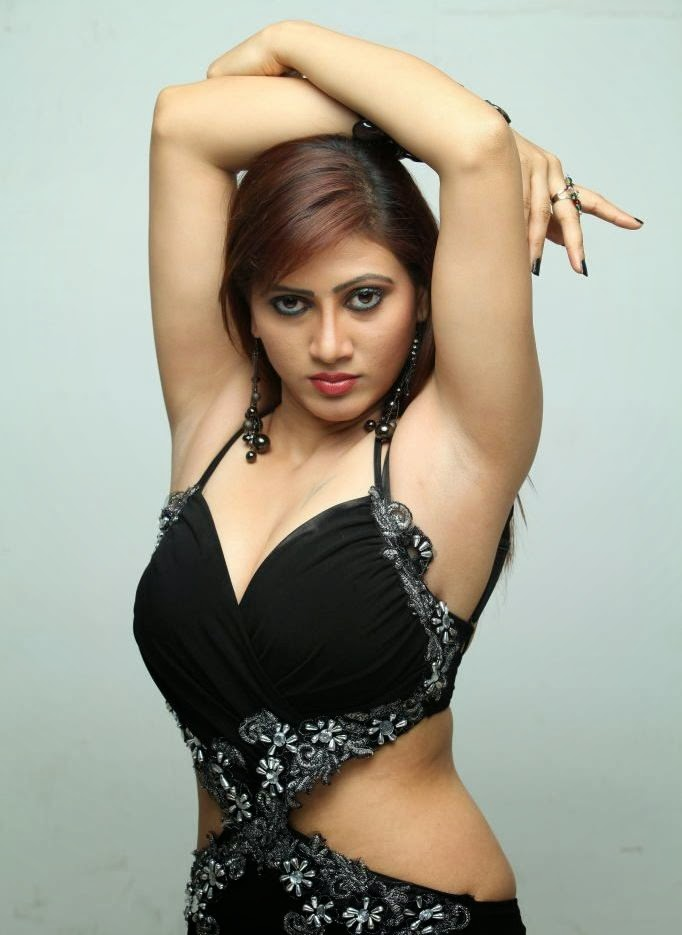 Rishika hot pictures in black transparent saree