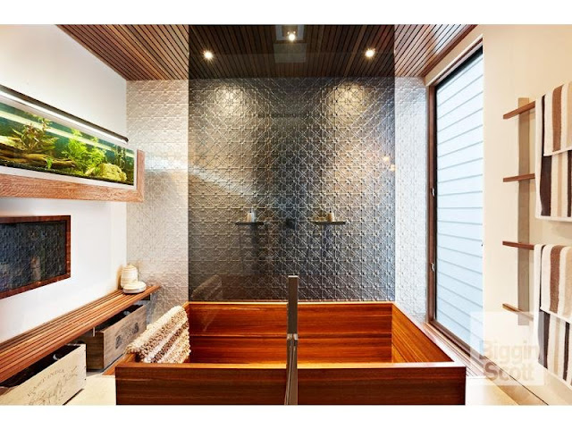 Photo of wooden bathtub in modern designed bathroom in Australian home