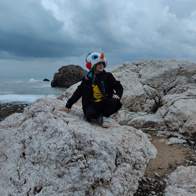 child in snowman hat at Aphrodite's Rock, Cyprus