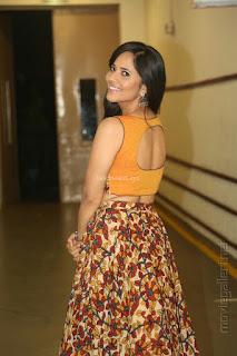 Telugu TV Anchor Anasuya Bharadwaj in backless tank top and skirt spicy pics January 2017
