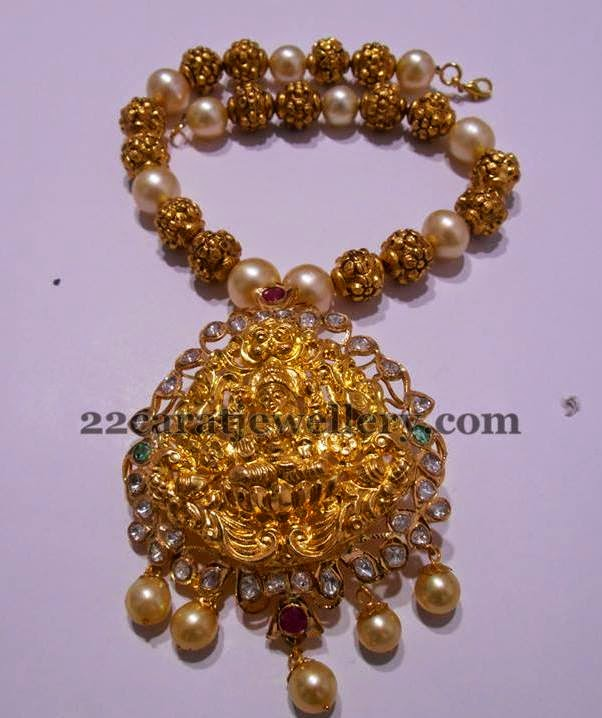 South sea pearl choker with diamond emerald pendant and taar mala strung with south sea pearls, nakshi balls, emerald beads and tanzanites by Amarsons Pearls & Jewels.