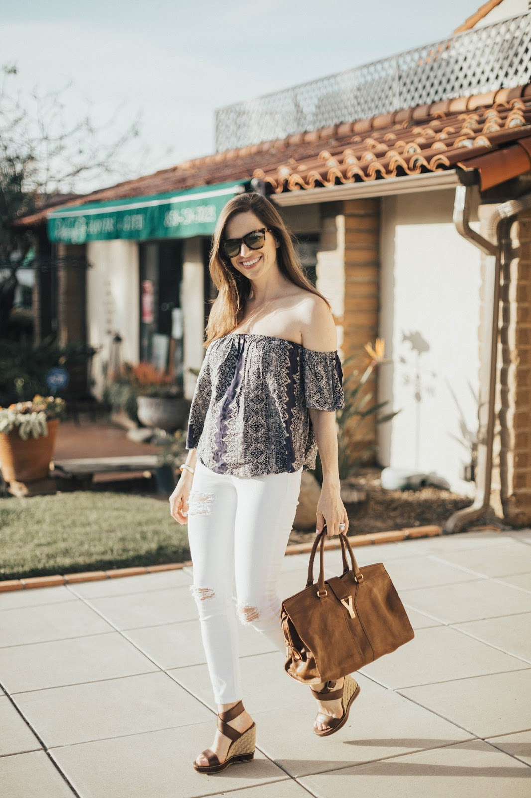 off the shoulder top and white jeans outfit