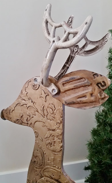 recycled reindeer with license plate ears and ceiling fan blade holder antlers