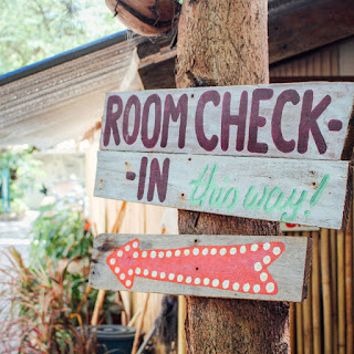 photo of the sign for room check in at Adang Sea Divers