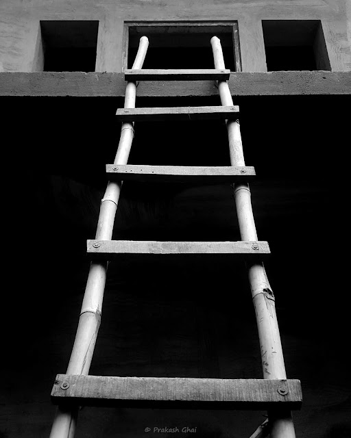 A Black and White Minimalist Photograph of a Wooden Ladder shot via Samsung S6 Smartphone Camera
