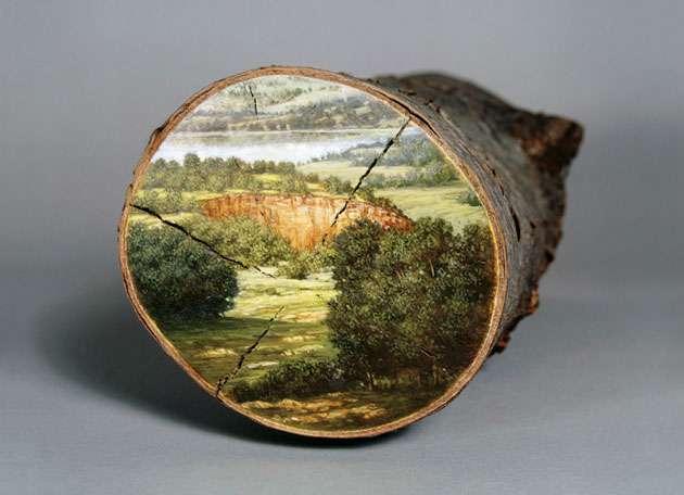Alison Moritsugu lukis pemandangan pada pokok yang di tebang.