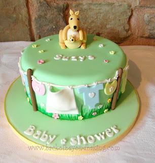 Baby clothes baby shower cake