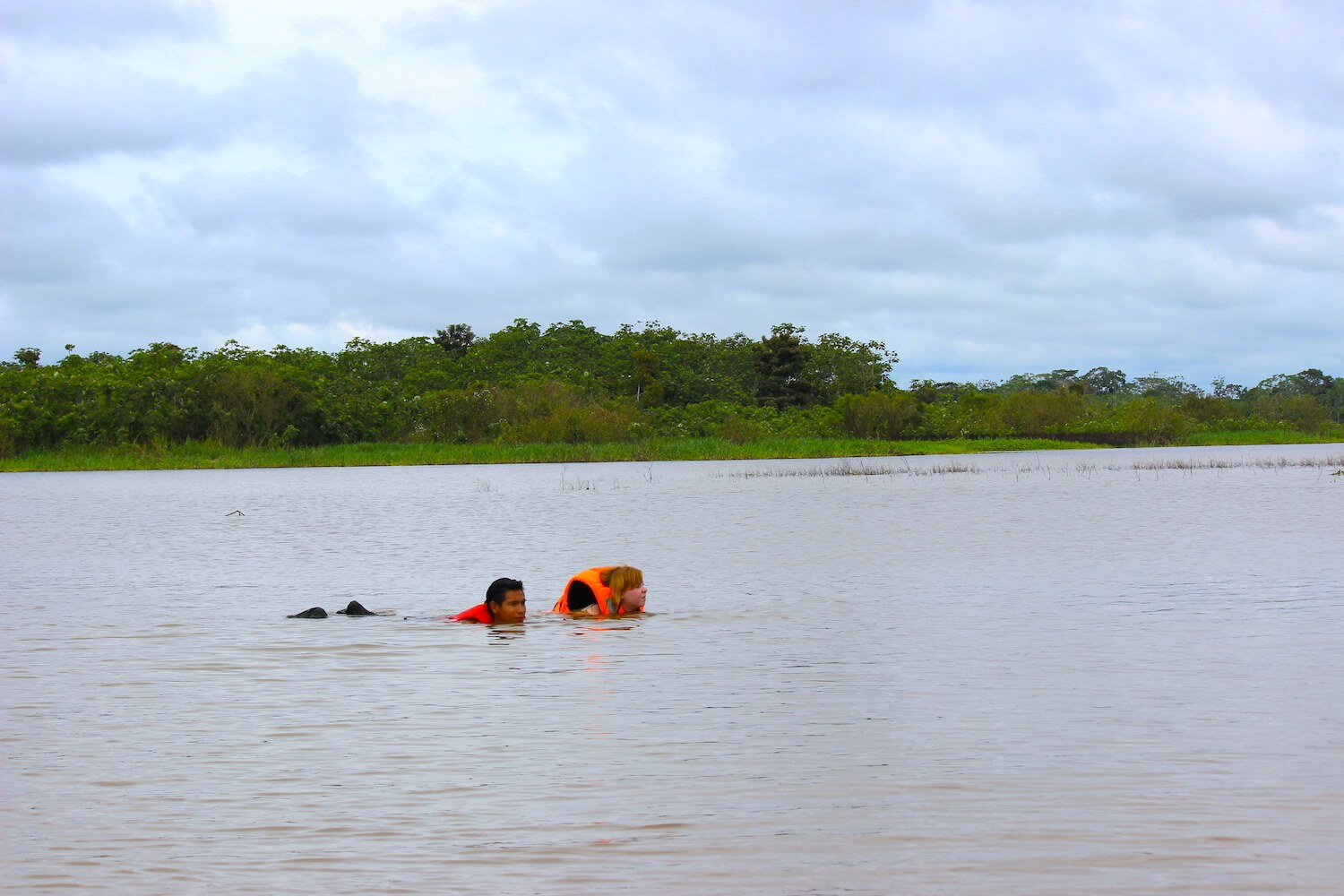 peruvian amazon swimming in river