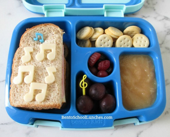 Music notes on a simple sandwich bento lunch