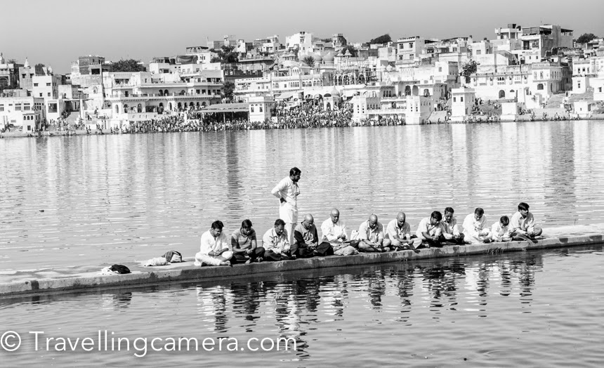 7 years back when I started learning and practicing Photography seriously, I planned to visit Pushkar Camel Fair. It's a very good place to go and shoot diverse things - people, action, games, camels, colorful dresses, dance performances, trades, mela, temples, lake and lot more. It's definitely worth exploring once and camera is a not must :). This Photo Journey shares 7 years old photographs from Pushkar, along with some of the experiences you can expect during Pushkar Camel Fair. My mentor told me about the fair, although I was not sure if I would be able to take out that weekend for Pushkar visit. On Friday evening, I realized that I don't have anything pending for weekend. So went home, packed my bag and reached ISBT Delhi. I got a comfortable bus from Delhi bus-stand to Ajmer. It was a good ride from Delhi to Ajmer in Rajasthan Road Trasport bus. Bus dropped me at Ajmer before 5am. Again took a local bus and reached Pushkar town. It was very cold in the morning, so took out my jacket and started searching for a place to stay & keep my stuff safe for next two days. It's recommended to do advance booking if you want to stay in a good hotel, otherwise smaller options can be explored when you are there. But I am talking about it from my 7 years old experience :)I got a nice hotel along the lake-side. There are many havelis around the lake which have been converted into Hotels. During the fair, these hotels have special arrangements on roof-top to party and enjoy special evenings with friends. Above photograph is shot from the roof-top of my hotel. During my stay, I realized that many of these hotels also have dormitories. Lot of groups from Israel & other foriegn countries prefer to stay together and try to keep the cost low. That's how they can travel more to explore different parts of our country.  There is a 5-10 minutes walk from Bramha temple to the grounds where Camel Fair happens. There is a stadium in Pushkar which is mainly used for various games and competitions, in which camels, horses and elephants participate. Check out this video showcasing horse dance competition - This lake in Pushkar is huge and has religious importance. You can notice lot of religious activities happening around the ghats. Lot of pandits may approach you to do different types of worships, so be very aware of all that. Don't indulge into any discussions with these guys, because I have seen these folks shouting on innocent folks roaming around and make them do different things without their wish. They create pressure on people by different means and at times, tourists feel helpless. It's sad to see such activities happening at such a beautiful place, because many times foreigners take back those bad experiences with themI am sure that you must be wondering about camels in this Photo Journey. I have lost most of my Pushkar shots in a HDD crash and these are picked from other locations & friends. So at Pushkar Camel Fair, you can expect lot of camels all around. Header photograph of this blog is also one of the shot from Pushkar.The fair happens every year in the month of October, so if you feel like visiting Pushkar Camel Fair this year, just check out the schedule and plan your visit. It's a week long fair, so you may want to check the schedule and decide appropriate days to visit Pushkar town in Rajasthan.Food at Pushkar Camel Fair is another special experience. It gets really hard to find Indian food in Pushkar, except some of the dhabas on fair ground. Most of the restaurants in main town serve non-Indian cuisine. They of-course charge higher but still reasonable :).  During the stay, make it a point to talk to local folks and try to undertsnad more about the Camel trading and various other activities of this fair. You would be surprised to know about some facts around pricing of camels, types of camels and how people bring them here etcPushkar is also a great place to capture some colorful portraits from Rajasthan State of India. I am sure that many of you can click far better portraits than what is shared on this blog.I am also trying to figure out the possibilities to visit Pushkar Camel Fair this year. Keep me informed if any of you want to come along. Comment back.. We can connect and plan together.