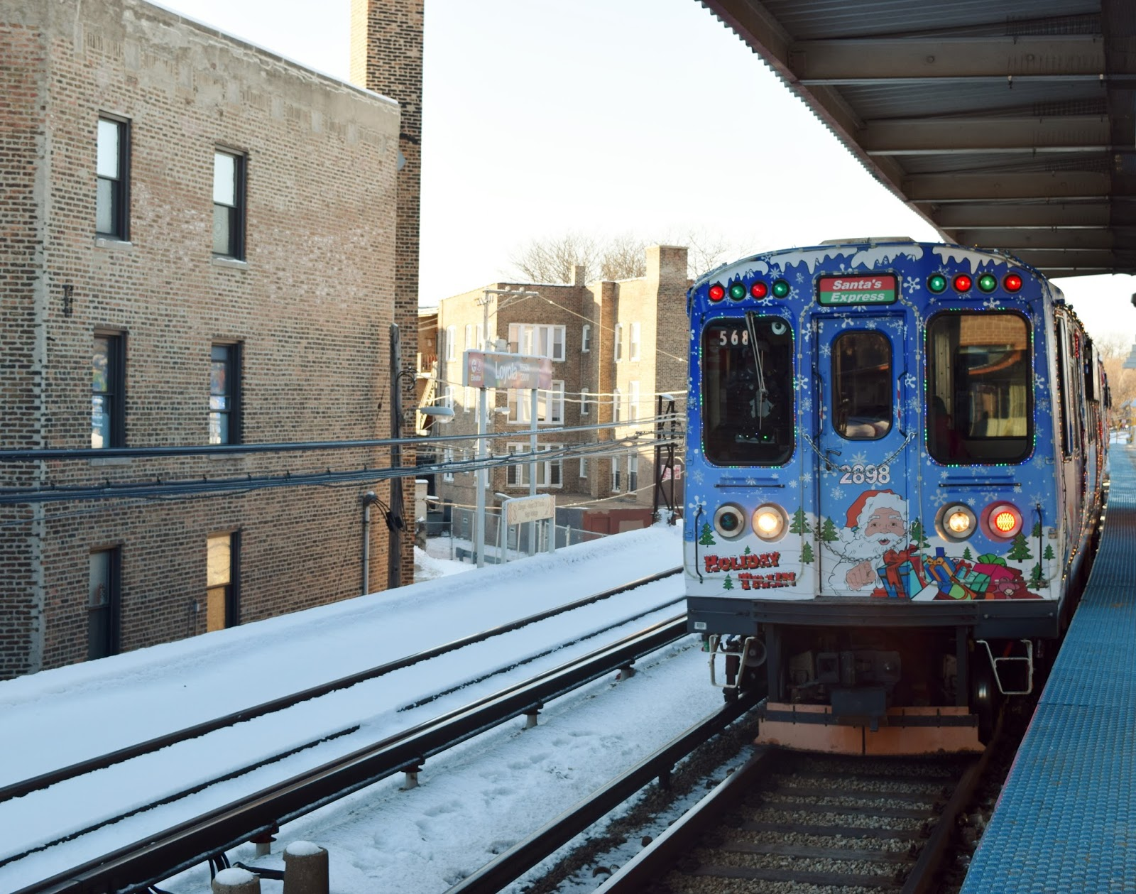 finally after about eight trains passed the holiday train arrived to much cheering from everyone on the train platform - Cta Christmas Train 2014