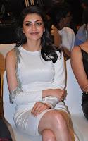 Beautiful Smiling Kajal Aggarwal in Creamy White Gown at MLA Telugu Movie Success Meet ~ .com Exclusive Pics 014.jpg